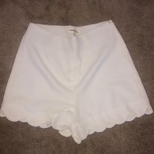 White scalloped shorts with side zip